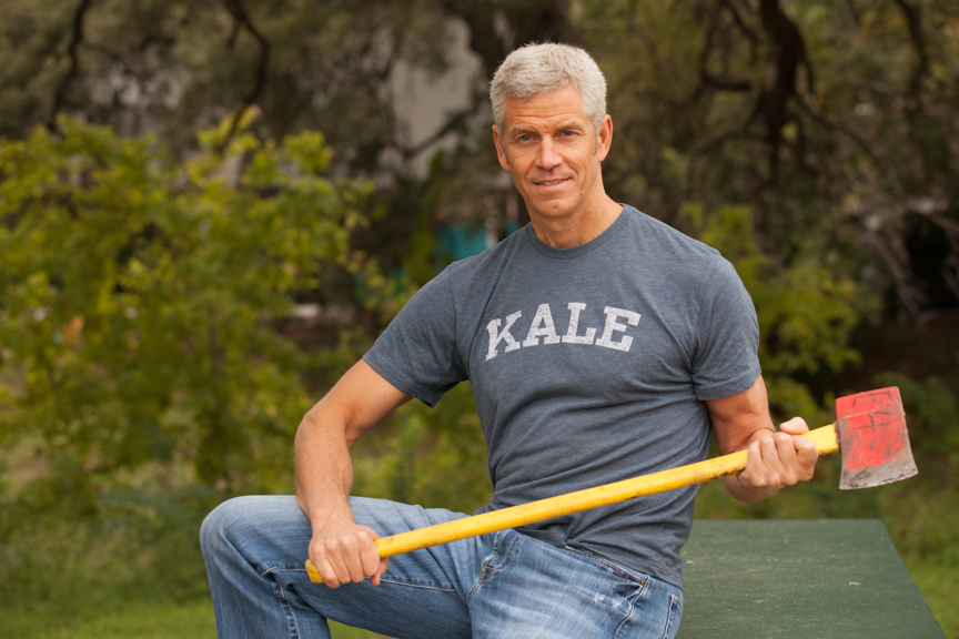 "Engine 2 Diet founder pictured holding an axe wearing a shirt that reads ""KALE"""