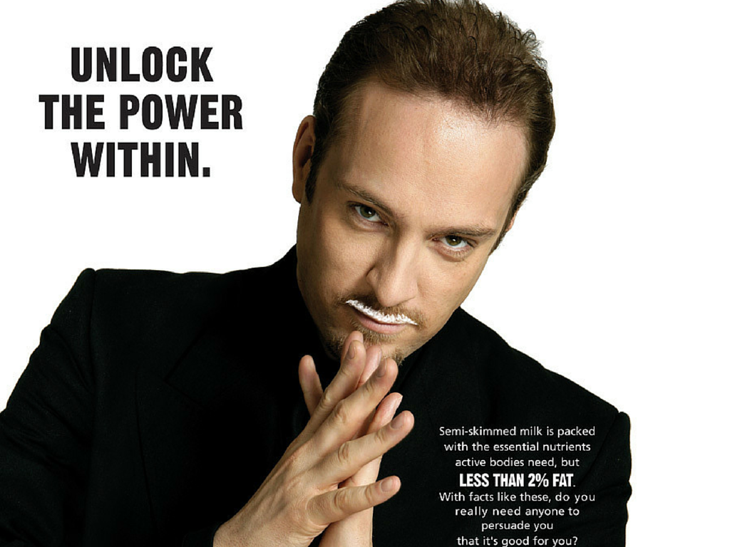 "Milk ad showing Derren Brown with a milk mustache; reads, ""Unlock the power within"""