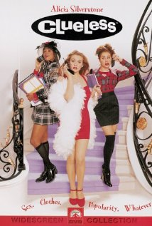 Movie poster for Clueless, shows Alicia Silverstone holding a cell phone and wearing a minidress and heels wrapped in a boa on a staircase