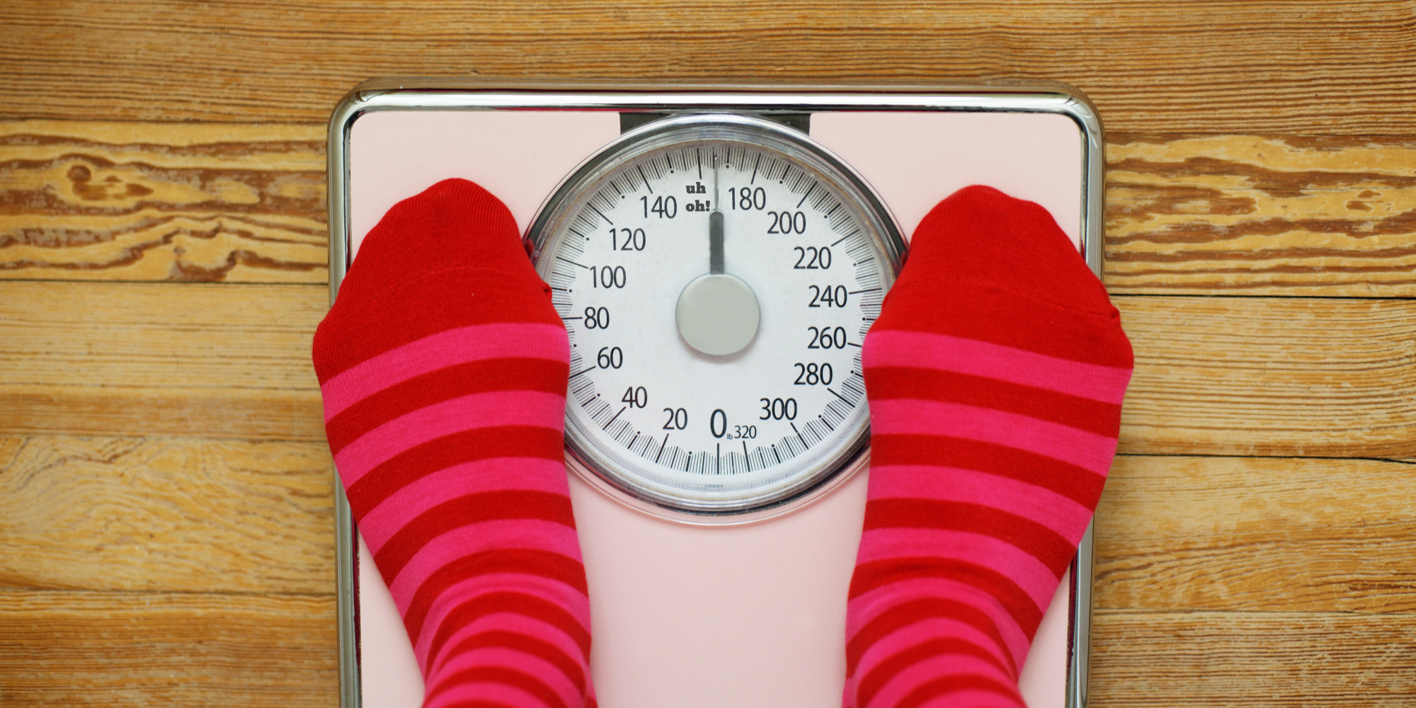Pink striped socks standing on pink scale